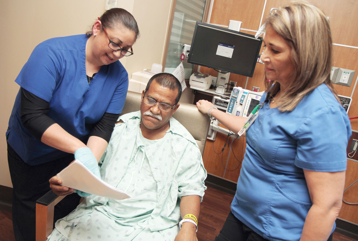 A patient receives attention at Parkland Memorial Hospital in Dallas.