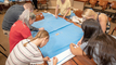 Nurses sew surgical wraps into sleeping bags for the homeless