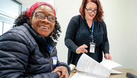 Cydney Franklin learns about her Medicare options from Ayse Tokbay.