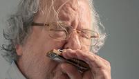 Jim Allison playing the harmonica