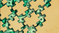 Puzzle pieces on money background