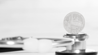 coin sitting on stethescope stock image