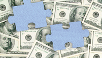 Two puzzle pieces on a background of money.