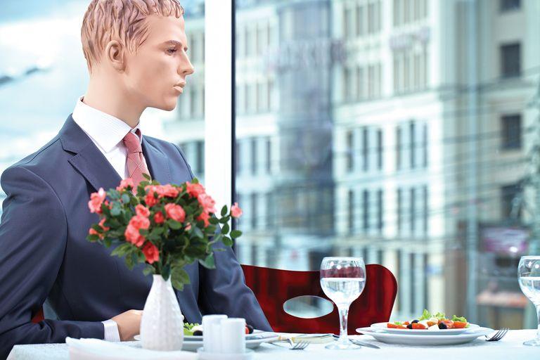 Mannequin sitting in a restaurant