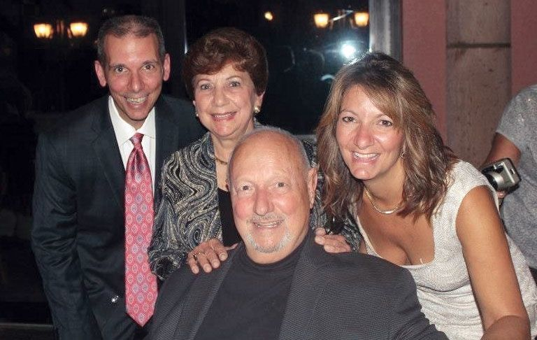 Dr. Anthony Slonim, in back at left, lost his father, also named Anthony, to COVID-19 on April 14. The elder Mr. Slonim is seated, flanked by his wife, Addie, and daughter, Donna Giuliano.