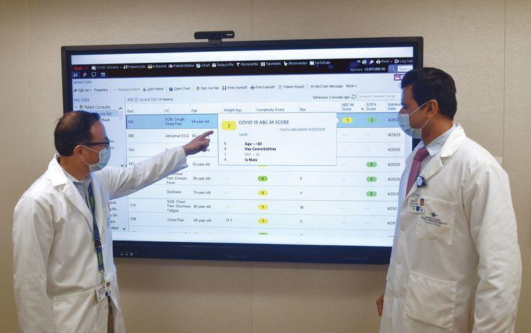 Hospitalists Drs. Clifford Wang and Sanjay Kurani examine data at Santa Clara Valley Medical Center.