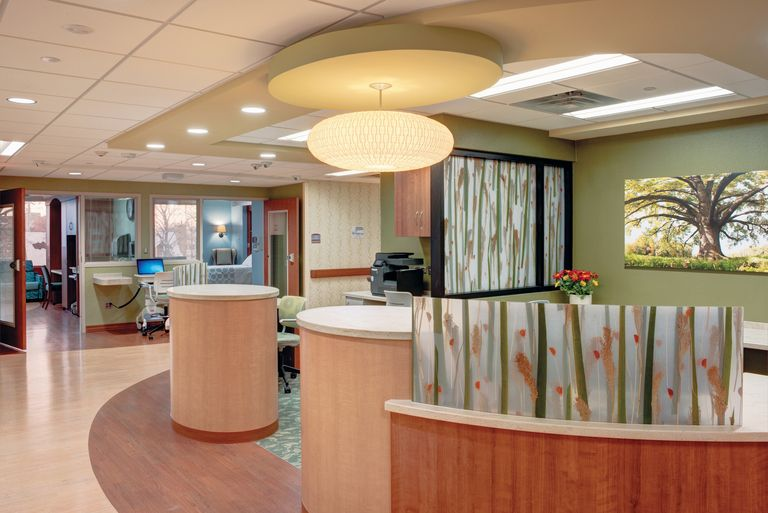 Flexible nurse work areas, such as this one at a Cancer Treatment Centers of America facility in Chicago, can feature direct visual access to rooms and nearby team work space.