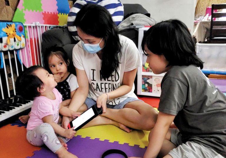 Dr. Ma Carla Angela Evangelista with her children