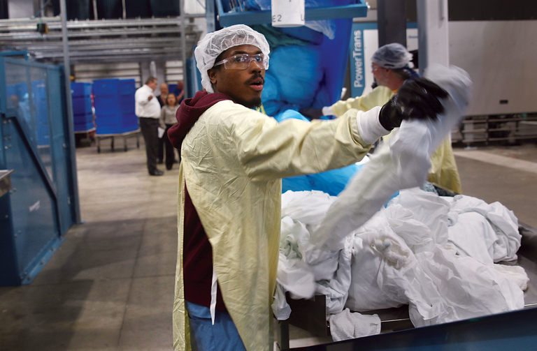 Worker doing laundry