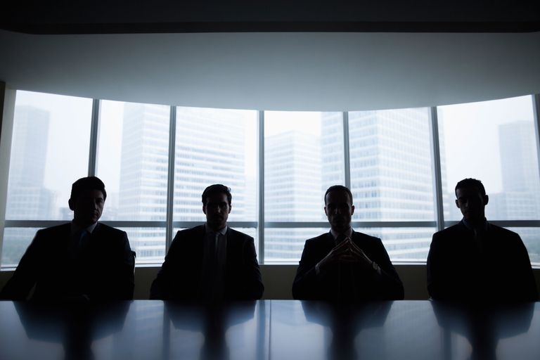 Male executives in a boardroom.