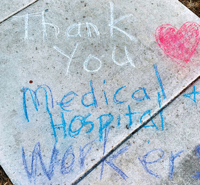 Thank you message to healthcare providers on the sidewalk