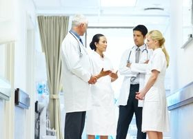 doctors and nurses standing in hospital talking