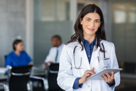 doctor ipad woman stock image
