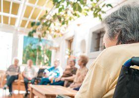 Seniors Socializing In The Hall Of The Retirement Center