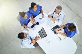 clinicians sitting around desk