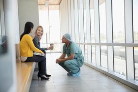 doctor speaking to women