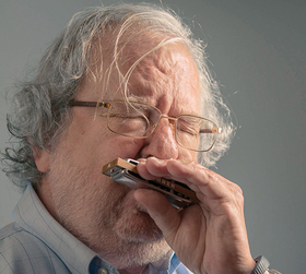 Jim Allison playing the harmonica