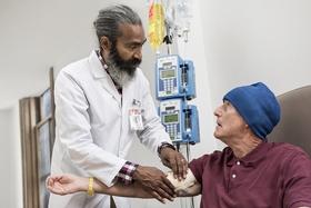 doctor helping patient stock image Sandoz