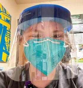 Lauren Hoffman wearing a mask and a face shield