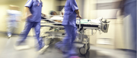 rushing patient down hall stock image