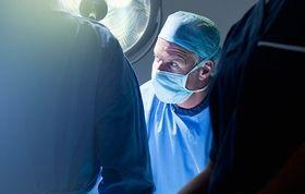 surgeon operating stock image