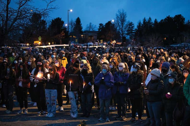 Mourners attend a vigil in Boulder, Colo., to remember the victims of a mass shooting at a local supermarket on March 22.