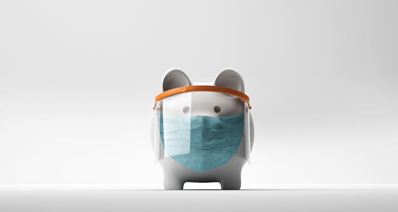 A piggy bank wearing a face shield and a mask.