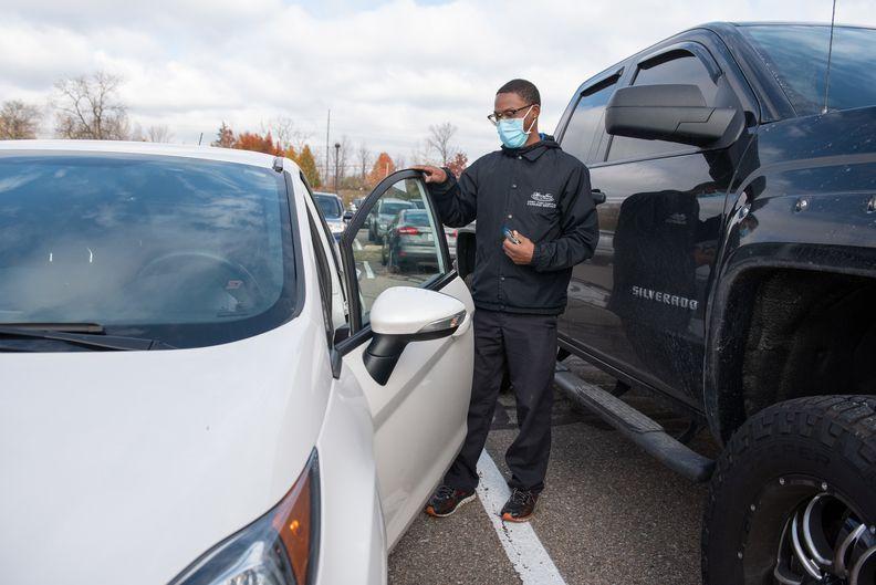 Kenneth Douglas closing a car door.