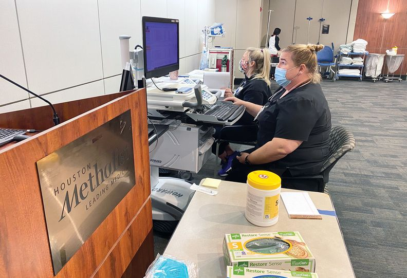 Healthcare workers in a triage dialysis center.