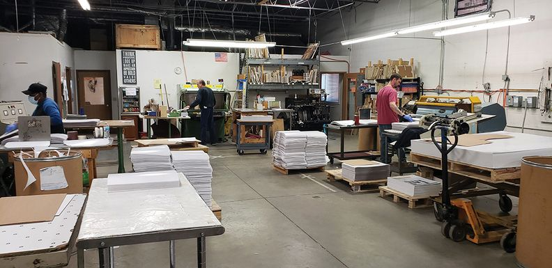 Workers at Holland, Ohio-based Ottawa Rubber Co., an injection molding and die-cutting manufacturer, make parts for the head straps that go onto face shields.
