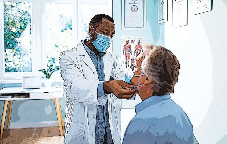 A doctor wearing a mask examining a patient wearing a mask.