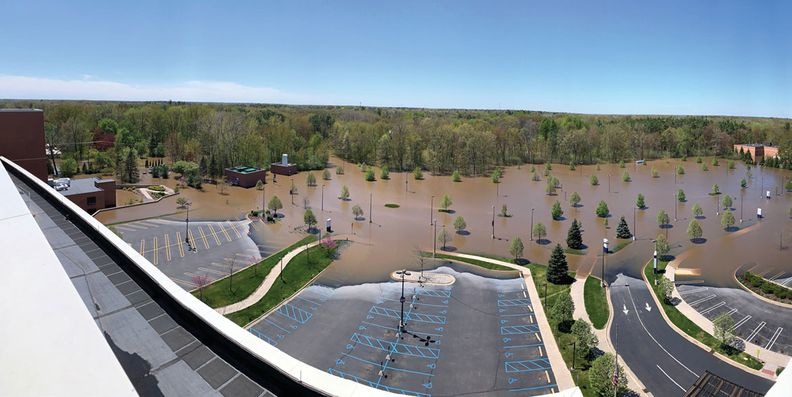 Floodwaters swept into MidMichigan's parking lot.