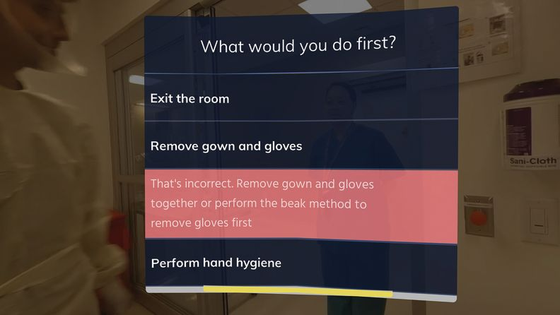 A virtual reality module on doffing PPE reviews steps a doctor has to take before leaving a patient's room.