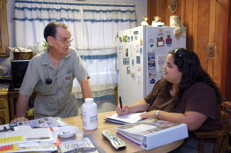 Hospice team member talking with a care team member.