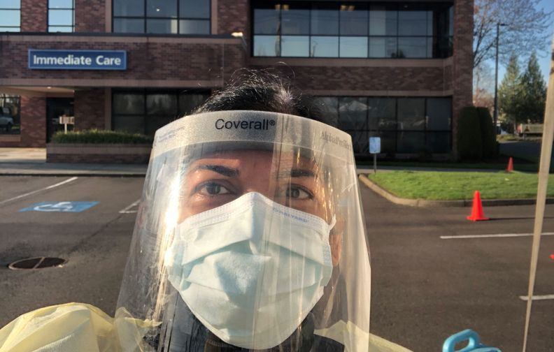 Dr. Poombavai Nagappan, an internal medicine physician, sees patients outside her clinic at Providence Medical Group–Scholls in Tigard, Ore.