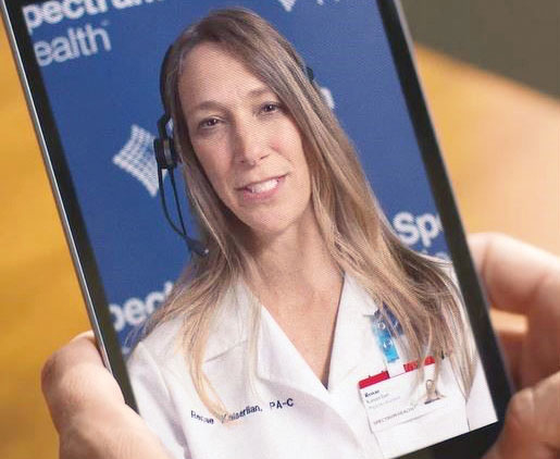 Doctor consulting with a patient on Spectrum Health's telehealth app