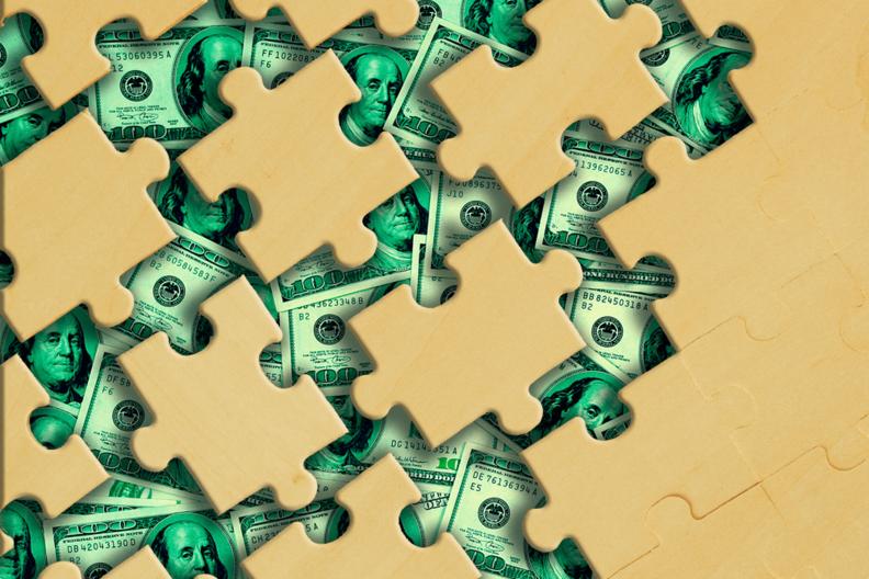 Puzzle pieces on money background