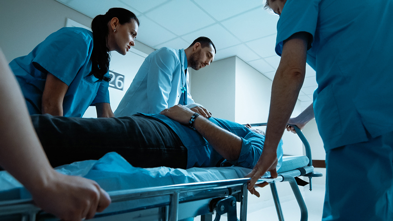 Doctors and nurses moving a patient