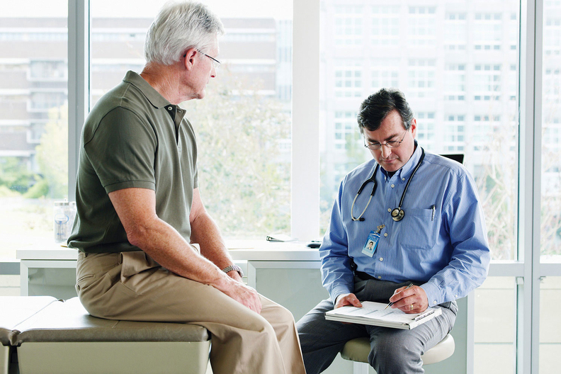 An older patient talking to a doctor