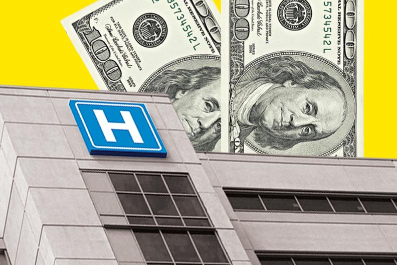 A hospital building next to hundred dollar bills.