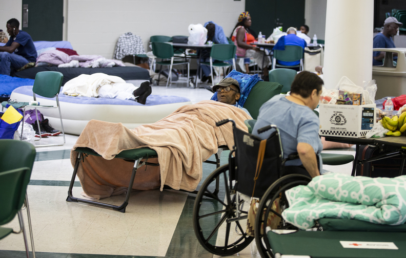 People try to get some rest at Lincoln High School as Hurricane Michael approaches.