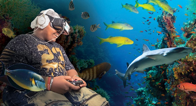 A patient at St. Jude Children's Research Hospital plays a virtual reality game called Aqua.