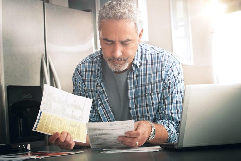 Man looking at medical bills