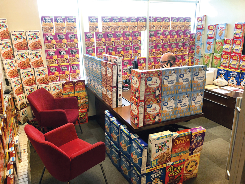 David Dawson with cereal boxes stacked in his office