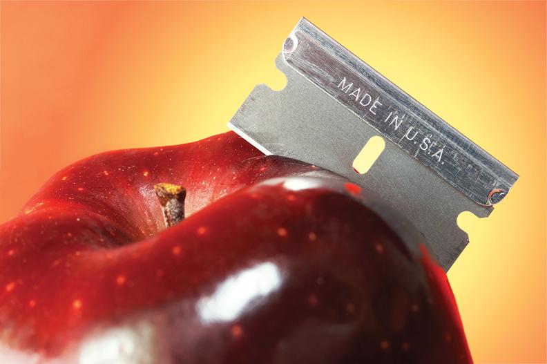 Razor blade stuck in apple