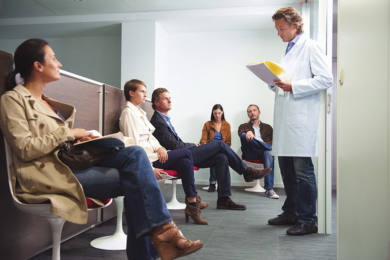 Doctor with patients in a clinic waiting room