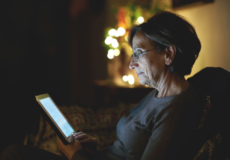 Older woman using a tablet.