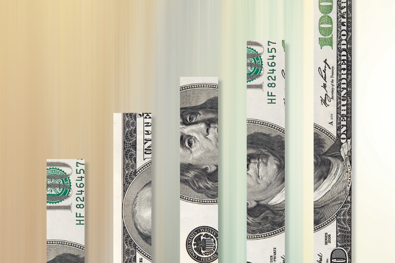 A hundred dollar bill cut into strips with a colorful background.